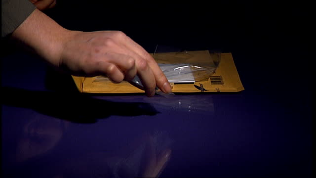 anonymous person unpackaging sachet of mephedrone and sprinkling powdered drug onto table surface - sachet stock videos & royalty-free footage