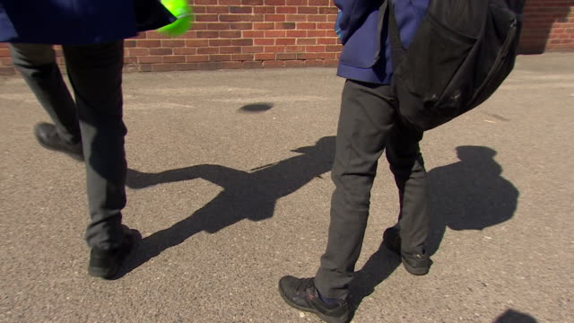 anonymous schoolchildren kicking football against wall in playground crewe - unrecognisable person stock videos & royalty-free footage