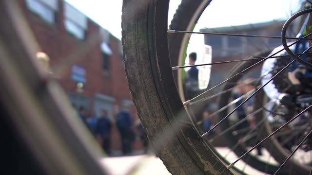 anonymous senior school pupils in playground filmed through wheels of bicycle crewe - playground stock videos & royalty-free footage