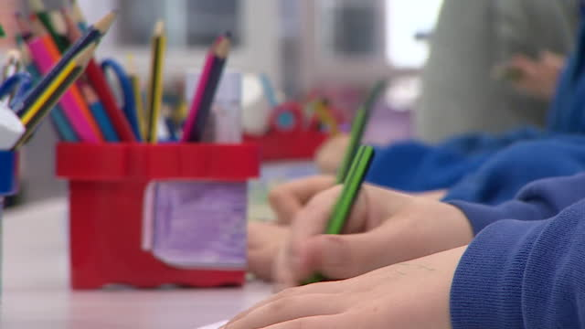 anonymous shot of primary school children colouring in - elementary school stock videos & royalty-free footage