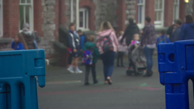 anonymous shots of children arriving at school on their first day back after coronavirus lockdown plymouth - unrecognisable person stock videos & royalty-free footage
