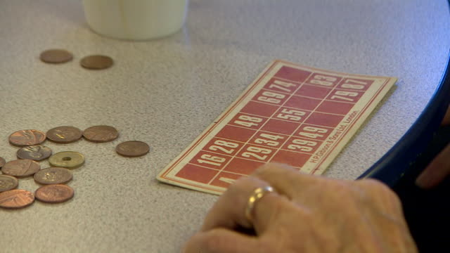 stockvideo's en b-roll-footage met anonymous shots of elderly people playing bingo at age uk centre in camden - bingo