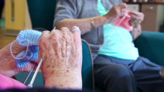 Anonymous shots of elderly women knitting in a nursing home