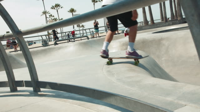 anonymous skateboarder drops in on a half pipe at venice beach skate park slow motion - half pipe stock videos & royalty-free footage
