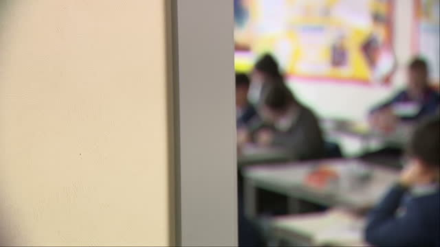 anonymous students sitting in class - unrecognisable person stock videos & royalty-free footage