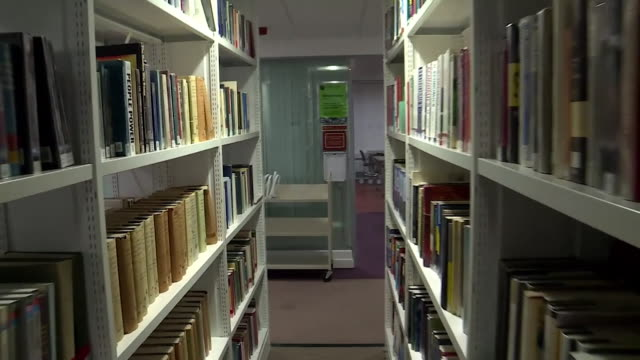 anonymous students working in university library - learning stock videos & royalty-free footage