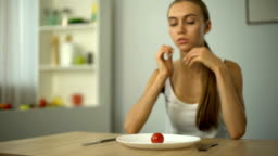 Anorexic girl feels dizzy, depleted by severe diets, exhausted body, starvation