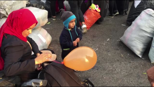 stockvideo's en b-roll-footage met another 367 refugees and migrants from lesvos and chios arrive at the port of piraeus on november 12 2019 the transfer of migrants from overcrowded... - athene griekenland