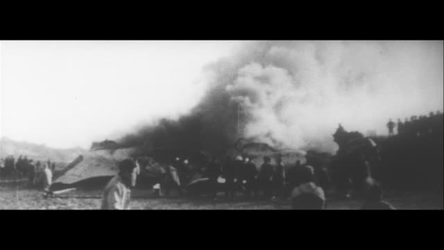 another air tragedy 20 people dead on fuji air lines/fuji air lines plane on fire, fire-fighters, transporting the injured, relatives running,... - lowering stock videos & royalty-free footage