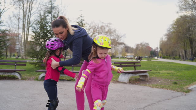 another exciting family day at public park - elbow pad stock videos & royalty-free footage