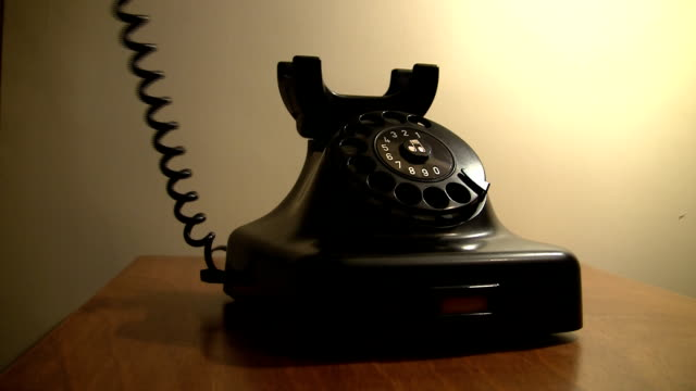 answering the phone - rotary phone stock videos and b-roll footage