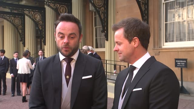 stockvideo's en b-roll-footage met ant and dec receive obes ext ant and dec interview re receiving obe holding obe medals up to camera sot - ant mcpartlin