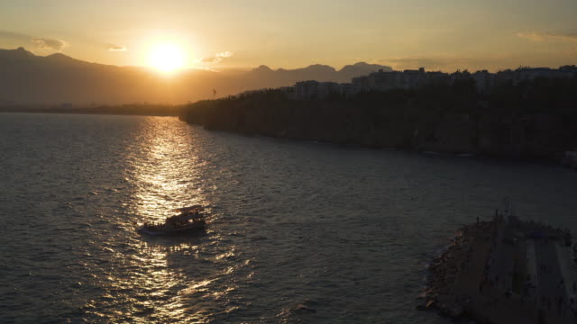 antalya harbour at sunset - ozgurdonmaz stock videos and b-roll footage