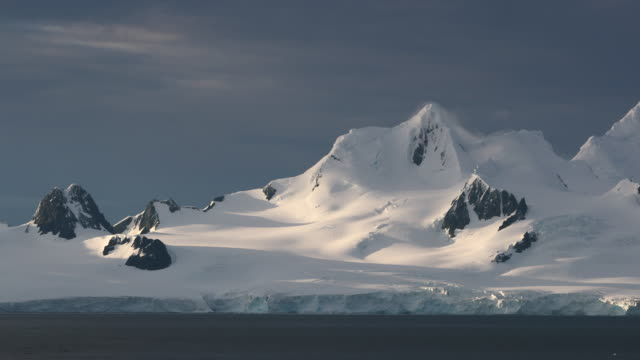 Antarctic Coastal Scenery, Mountains and Glaciers in Sunrise