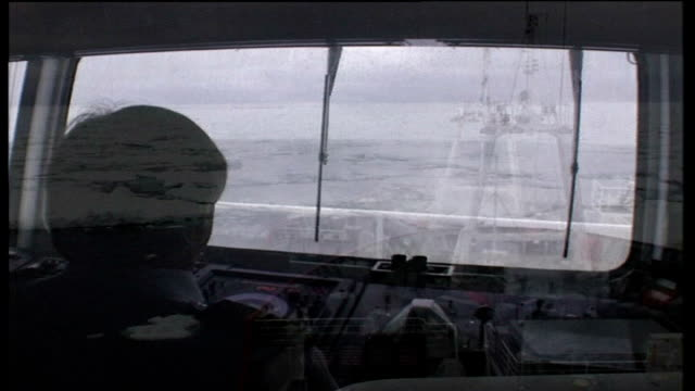 antarctic cruises; southern ocean: int view from bridge as ship ploughs through heavy waters at sea ext bow of ship along through ice floes at sea - antarctic ocean stock videos & royalty-free footage