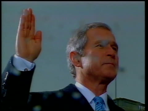 vídeos de stock, filmes e b-roll de antarctic ice sheet melting lib washington dc president george w bush holding right hand aloft as swearing in as president fade ms bush with wife... - tomada de posse