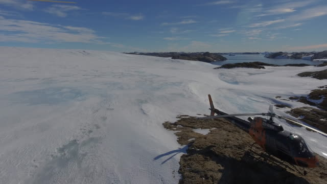 antarctica aerial over a helicopter in larsemann hills prydz bay close to bharati one of the indian stations - antarctica drone stock videos & royalty-free footage