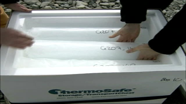 scientists investigate ice formations to predict possible climate changes; rob mulvaney and mcginty removing ice cores from refridgerated box - torso video stock e b–roll