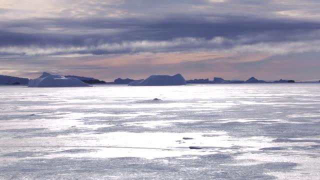 antarctica: ice landscape under cloudy sky - antarctica aerial stock videos & royalty-free footage