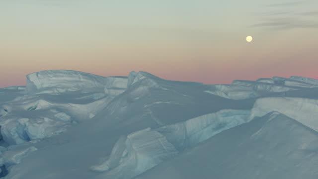 antarctica: ice landscape under twilight - antarctica aerial stock videos & royalty-free footage