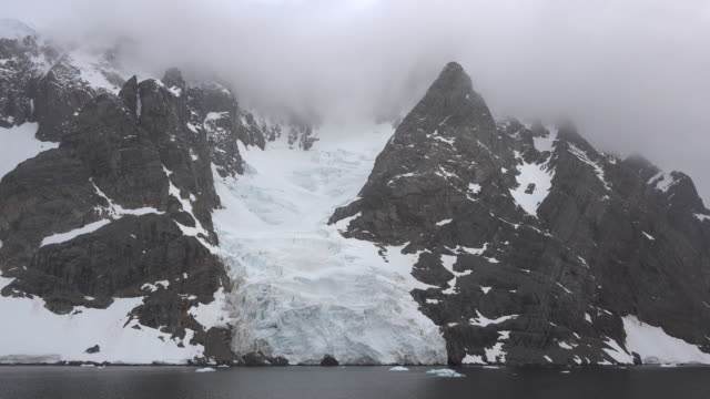 antarctica lemaire channel dramatic rock spike.mov - ice sheet stock videos and b-roll footage