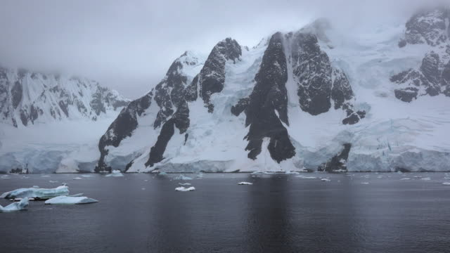 Antarctica Lemaire Channel horns rise from the sea