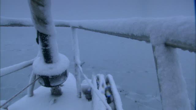 POV, Antarctica, Port Lockroy, Snow covered yacht moving through frozen sea