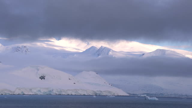 antarctica  snowy mountain - antarctica sunset stock videos & royalty-free footage