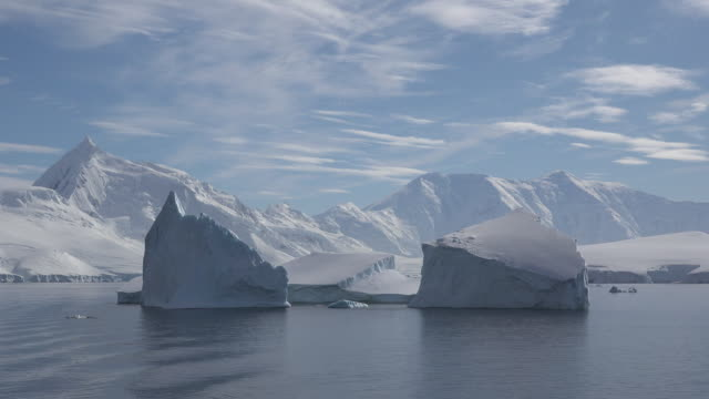 antarctica two square icebergs time lapse - antarctica iceberg stock videos & royalty-free footage