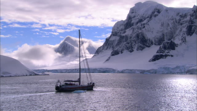 ms, pan, antarctica, yacht sailing in scenic inlet - inlet stock videos & royalty-free footage