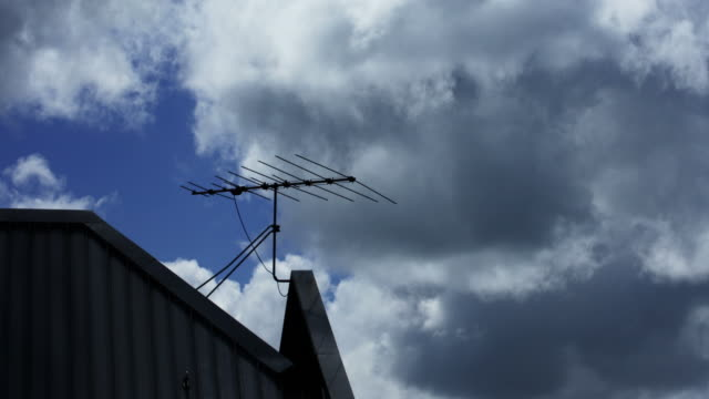 tv antenna on a rooftop - television aerial stock videos and b-roll footage
