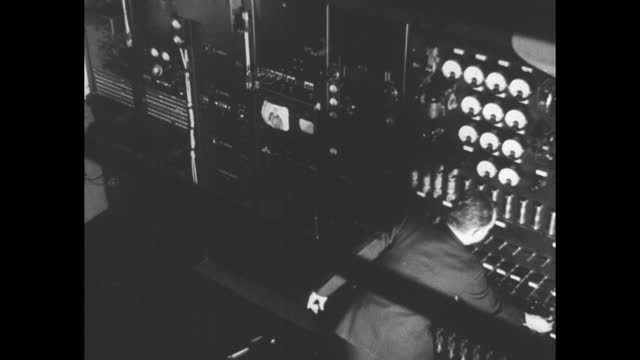 stockvideo's en b-roll-footage met antenna on top of empire state building / antenna / two men working in control room at transmitting station / pipes on ceiling / vs man taking high... - part of a series