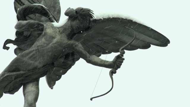 cu anteros statue covered in snow, piccadilly circus, london, united kingdom - longbow stock videos and b-roll footage