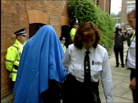 stockvideo's en b-roll-footage met anthony goodridge sentenced on child pornography charge ext pc antony goodridge led along from court under blanket to police van van away - kinderporno