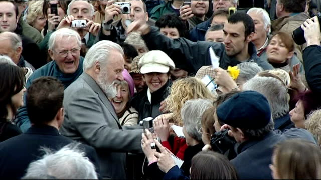 anthony hopkins unveils tommy cooper statue in caerphilly wales caerphilly ext actor sir anthony hopkins greeting crowds kissing some of women... - anthony hopkins stock videos & royalty-free footage