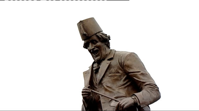 anthony hopkins unveils tommy cooper statue in caerphilly wales caerphilly ext sir anthony hopkins unveiling tommy cooper statue and crowd applaud... - comedian stock videos and b-roll footage