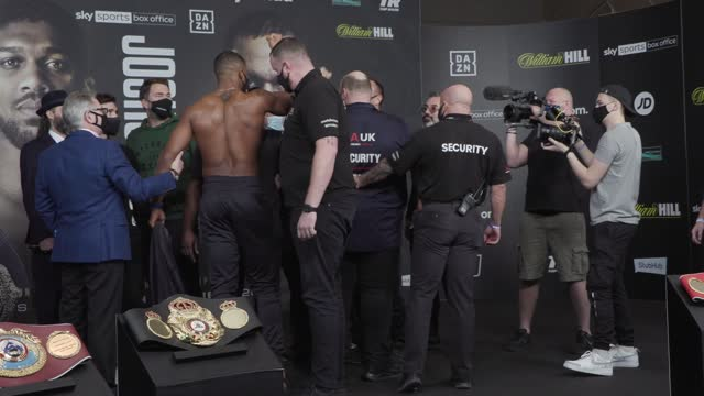 anthony joshua and kubrat pulev weigh-in ahead of saturday's heavyweight title fight in london. the two exchanged words and small scuffles broke out... - wembley arena stock videos & royalty-free footage