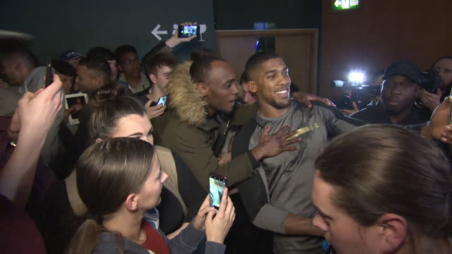 anthony joshua mingling with fans in cardiff before his unification fight with joseph parker - autogramm stock-videos und b-roll-filmmaterial