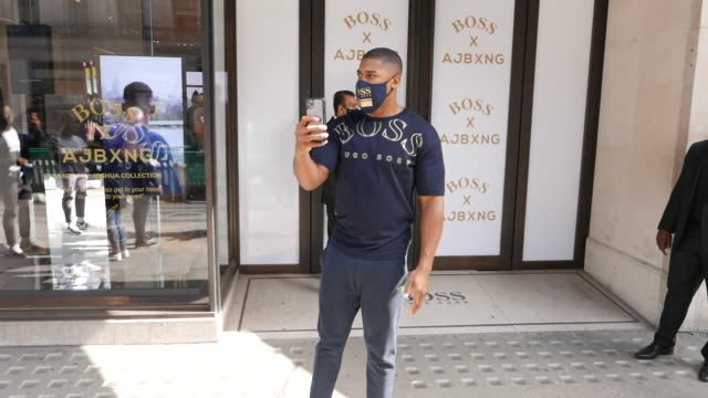 anthony joshua outside the boss capsule collection photocall with anthony joshua at hugo boss store on september 02, 2020 in london, england. - clothes shop stock videos & royalty-free footage