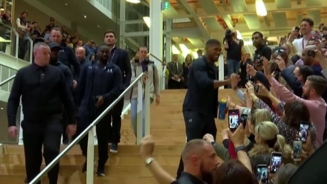 Anthony Joshua prepares for match against Joseph Parker ENGLAND London INT Anthony Joshua down stairs and giving high fives to crowd