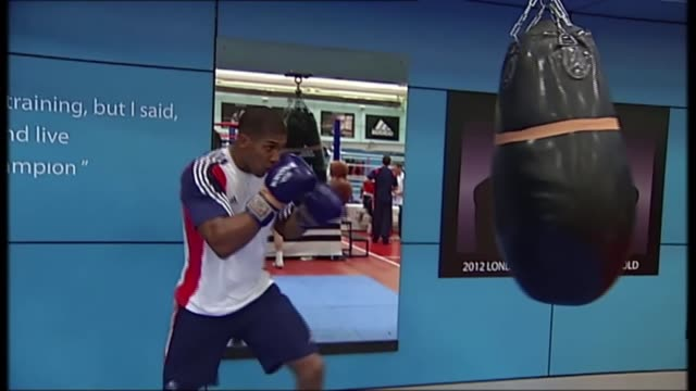 anthony joshua prepares for match against joseph parker t23111109 / various shots anthony joshua hitting punch bag in gym - anthony joshua boxer stock videos & royalty-free footage