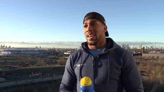 Anthony Joshua puts forward anticrime message ENGLAND London Stratford EXT Various of people jumping up and down as part of exercise session Low...