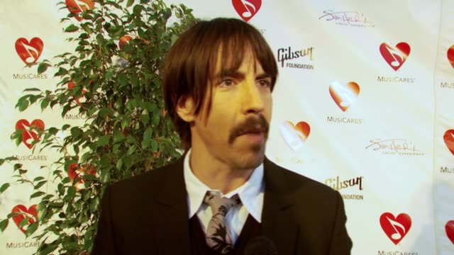 vídeos de stock, filmes e b-roll de anthony kiedis on the importance of attending the event and the message he hopes to send to fans by attending the event at the 3rd annual musicares... - send
