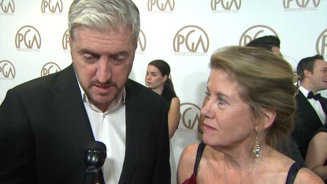 vidéos et rushes de anthony mccarten, lisa bruce on the theory of everything being nominated at 26th annual producers guild awards in los angeles, ca 1/24/15 - producer's guild of america awards