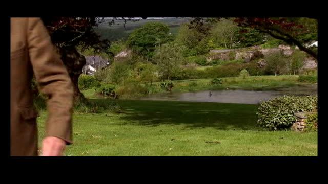vídeos y material grabado en eventos de stock de anthony steen mp running towards general views steen's house steen in garden looking at newspaper - bbc radio