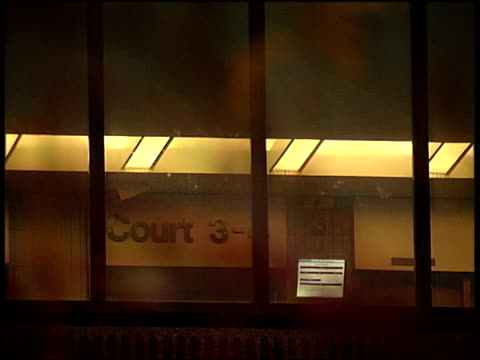 defendant gives evidence liverpool queen elizabeth ii law courts ms branches of tree outside court pull focus to sign for 'court 3' seen through... - defendant stock videos & royalty-free footage