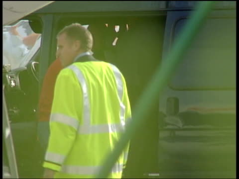 defendant gives evidence tx 4805 john lennon airport murder suspects michael barton and paul taylor along to van as arrested on return to britain... - defendant stock videos & royalty-free footage