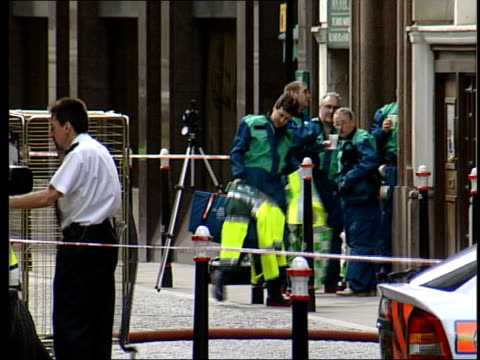 uk/worldwide scares itn england london stock exchange stock exchange tilt down to emergency service vehicles below lms decontamination officers... - shower curtain stock videos and b-roll footage