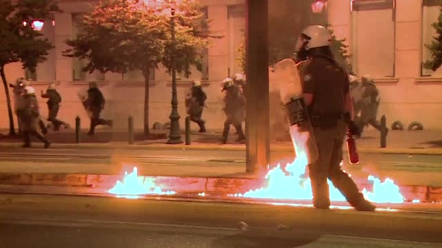 Anti austerity protesters hurled petrol bombs at police in front of Greece's parliament on Wednesday as lawmakers began debating deeply unpopular...