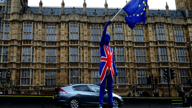 Anti Brexit demonstrators continue their protest outside the Houses of Parliament on March 29 2018 in London United Kingdom British Prime Minister...
